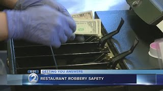 Businesses examine security measures after rash of armed robberies