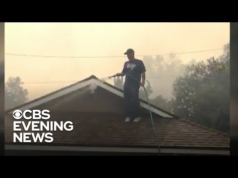Neighbor stays behind to save homes from wildfires