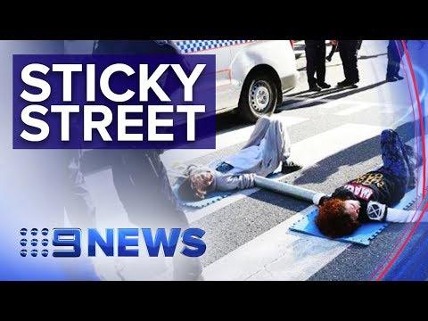 Adani Mine Protestors Glue Themselves To Busy Brisbane Street   Nine News Australia