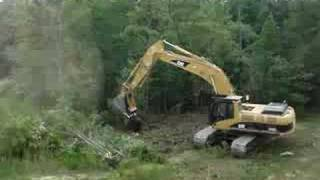 CAT 330C Hydraulic Excavator tearing down trees (1/4)