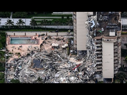 Miami building collapse: Rescuers listen for signs of life in rubble
