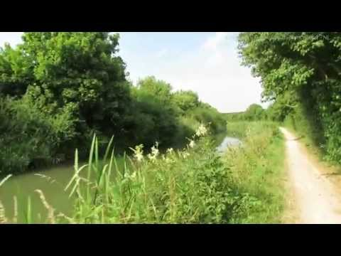 Solitary Barge Cruising on Grand Union Canal near Tring in Hertfordshire 01