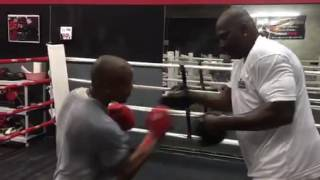Padman Mcgriff doing pads with former UFC fighter MMA kickboxer Marcus Brimage