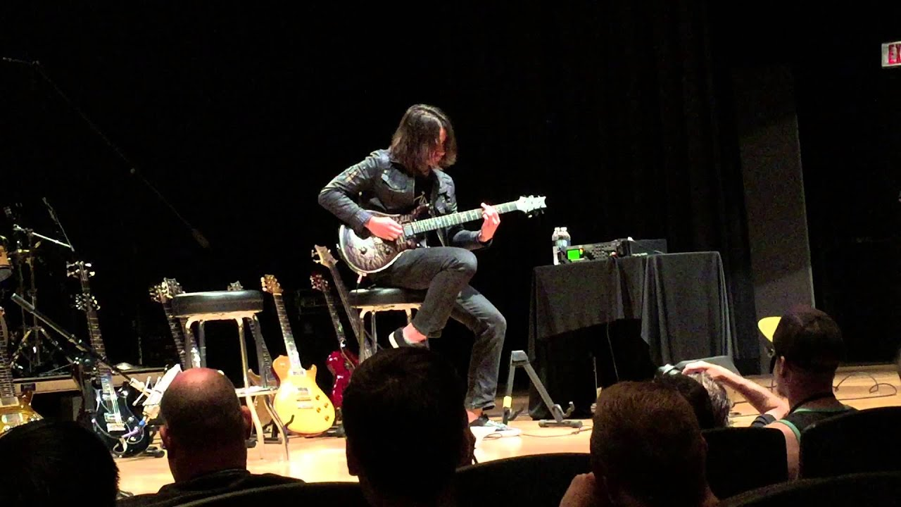 Periphery's Mark Holcomb playing PRS guitar at Sweetwater ...