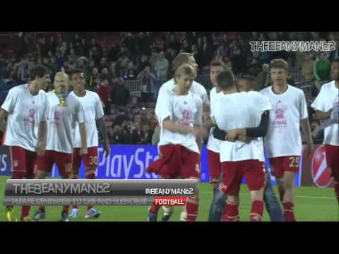 Bayern Munchen players celebrate with a fan who gets past security at Camp Nou