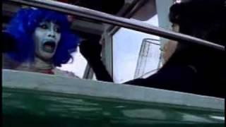 Another great scene from Chouriki Sentai Ohranger vs. Ninja Sentai Kakuranger. A school girl is terrified by a clown/tongue monster on a fairground ride.