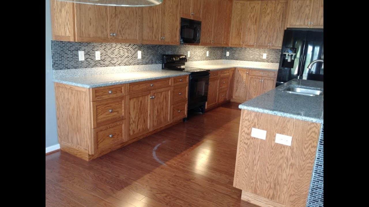 Oriental White Granite Countertops On Medium Wood Cabinets