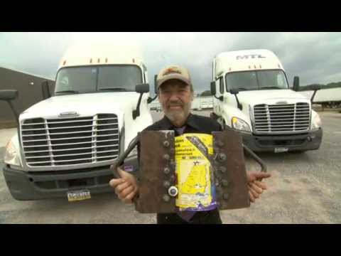 Tearing two interlaced phone books apart using two 18 wheeler trucks