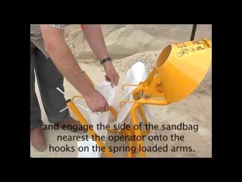 Sandbag Filling For Emergencies - The Civilian Sandhopper - Q.mov