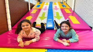 Masal and Öykü  have fun playing at the Indoor Playground for kids