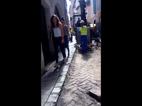 Women thru a construction site