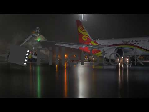 Hainan Airlines aircraft being de-iced before night departure from  Sheremetyevo 1bb9587cd118d