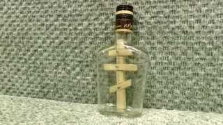 Православный крест в бутылке