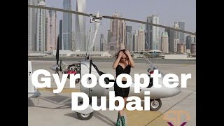 Gyrocopter Girl Flying Dubai Fashionably with Bulgari heels on