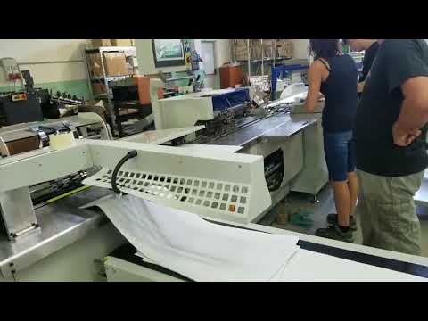 Automatic Twin loop wire binding and punching machine PBW580S work in Italy customer