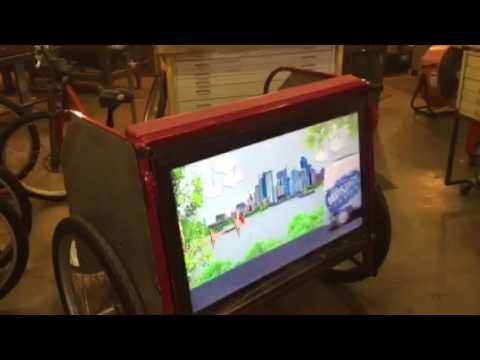 Digital screens on Austin pedicabs