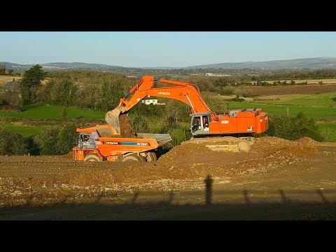 Hitachi Zaxis 870 LCH excavator earthmoving with Hitachi EH1100 dump trucks