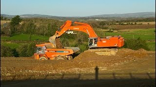 Hitachi Zaxis 870 LCH excavator earthmoving with Hitachi EH1100 dump trucks