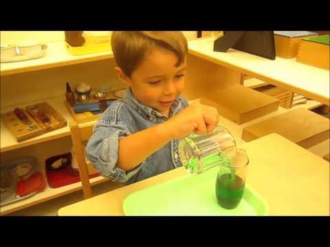 Montessori funnel pouring work   Children's House   Bluffview Montessori School