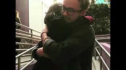 Tom Felton hugging a little girl at HPW