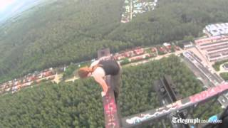 Russian daredevil larks about on top of radio tower in Moscow