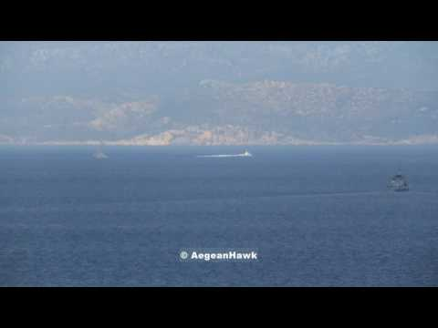 Hellenic Navy Gunboat Mahitis class keep out of Greek waters a Turkish Coast Guard boat.