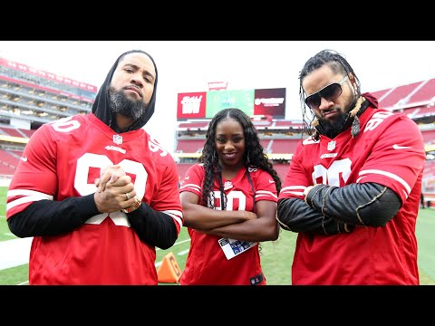 The Usos and Naomi meet San Francisco 49ers player with Connors Cure cleats