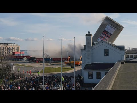 Denmark demolition goes wrong as silo falls wrong way