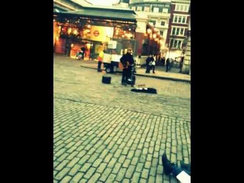 Mad World, street musician in London
