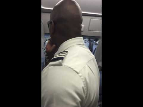 American Airlines Jamaican Pilot stops flight for Message