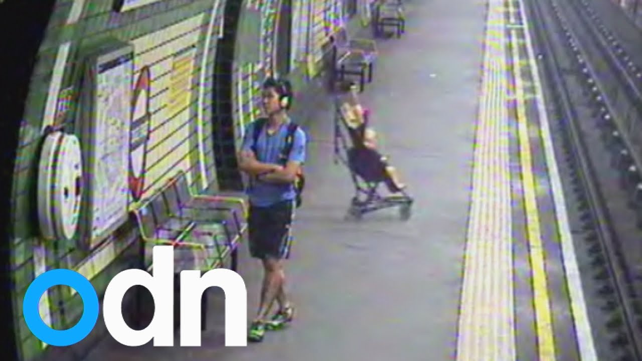 Terrifying moment child in a buggy is blown on to London tube tracks