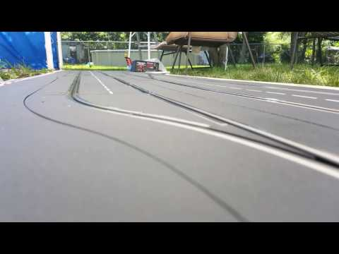 Carrera slot cars on road america track