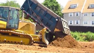 Mack dump truck dumping a load of dirt