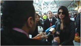 TOIFA 2013 Priyanka Chopra & Jimmy Shergill arrive at YVR Vancouver - Fans go crazy!