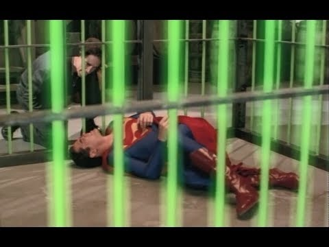 Superman caged in kryptonite by Lex Luthor