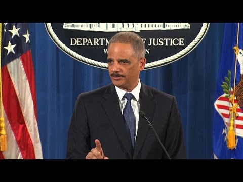 Holder calls for overhaul of Ferguson's police practices