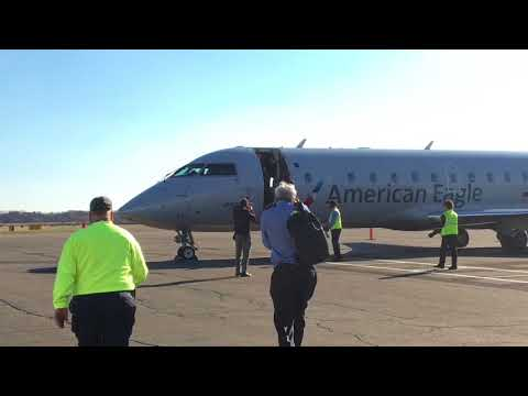 The first American Eagle Canadair RJ-200 regional jet lands at Tweed New Haven Regional Airport