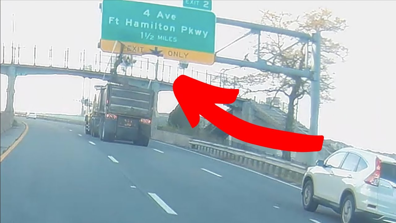 Dump Truck Crashes into Highway Sign