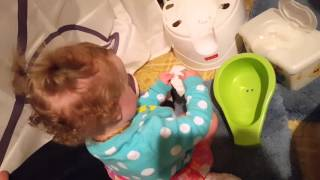 Baby Cleaning a Potty Chair