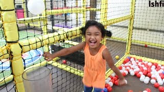 Funny Toddler Ball Pit Fun at Indoor Play Area for Children