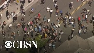 Unlawful assembly declared at California's Huntington Beach after protesters block street
