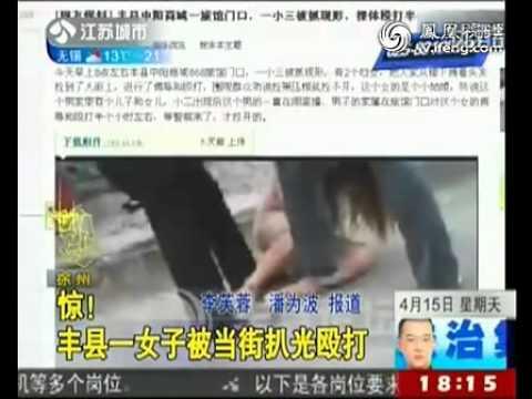 CLIPThiếu nữ bị lột quần áo, đánh đập giữa phố tai Trung Quoc (http://vxinh.net)