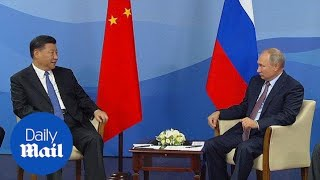 Vladimir Putin and Xi Jinping meet at Eastern European Forum