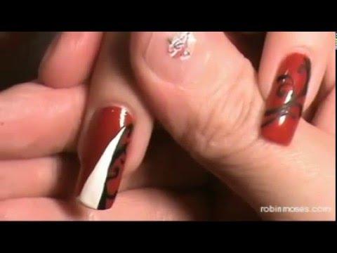 black and white filigree on red nails  elegant nail art