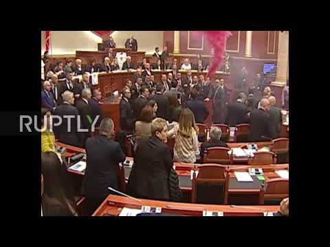 Albania: MPs shroud parliament in pink smoke in bid to halt elections