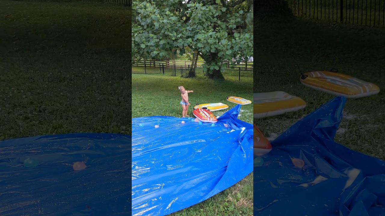Family slip and slide kickball - YouTube