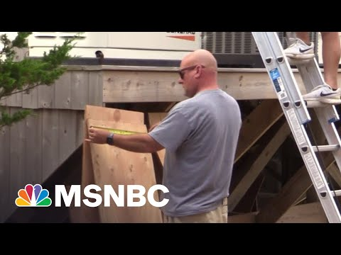 East Coast Shorelines Board Up Storefronts, Homes In Preparation For Tropical Storm Henri