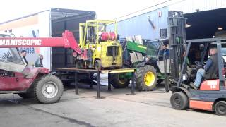 Loading a Forklift onto a truck... with Forklifts