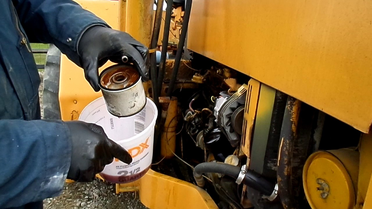 John Deere Fuel Filter replacement on the 310A Backhoe  YouTube