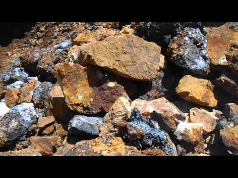 Sulphides or Pyrites oxidizing so fast it is actually burning.